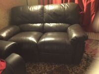 Dark brown leather reclining 2 seater sofa