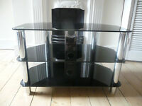 Black glass Television Stand. From smoke-free and pet-free home