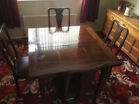 Extendable mahogany dining table and chairs