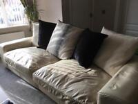 Free four seater cream leather sofa