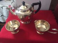 Silver plated tea pot with marxhing milk and sugar bowl.