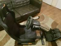 Playseat gaming chair with Logitech g29 wheel