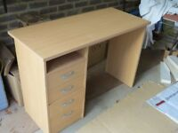 Office desk with four drawers.