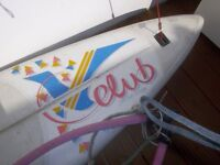Large windsurf board and sail needs a good clean Cheep
