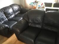 Black leather sofas, in vgc, can deliver