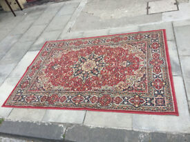 Rug , mainly red in colour . Feel free to view size 76 in x 52 in