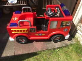 Children ride on electric fire engine