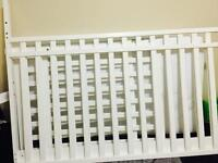White colour crib with matters and extra cover