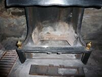 sed cast iron fireplace and hood