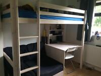 High bunk cabin bed with desk and sofa