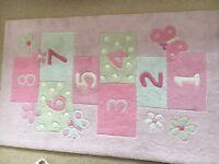 Pink hopscotch rug