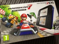 Blue/ black Nintendo 2ds for sale with Mario Kart 7 pre-installed
