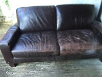 Chocolate brown leather sofa. Wooden legs. Free to a good home. Two seater. Wooden legs.