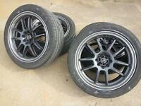 """215/45/17 - 4 bolt 17"""" rims with good rubber plus extra tires"""