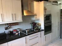 kitchen unit with neff microwave, neff oven, age induction job, fridge, sink, worktop and sink