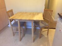 Wooden folding breakfast table and chairs. Table dimensions h 75 cm l75cm w90cm 45cm folded