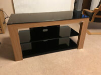 Stylish Norstone TV & HiFi stand with Oak finish & black glass shelves