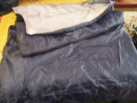 Adult sleeping bag navy blue with grey lining complete with carry bag