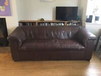 1970s three seater brown leather sofa, some wear, 2 small tears, a solid frame, well sprung.