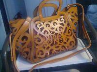 Cut Leather tan cross body / shoulder/ hand bag