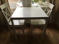 White metal and wooden IKEA dining table. Perfect condition. Seats two.