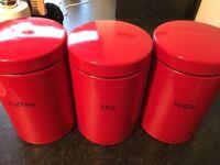 Red Brabantia kitchen canister set