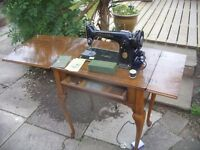 OLD SINGER SEWING MACHINE IN TABLE CABINET