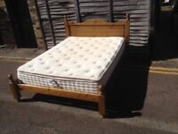 King size wooden bed with mattress