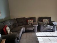 Grey & black corner sofa with matching chair. Very comfortable