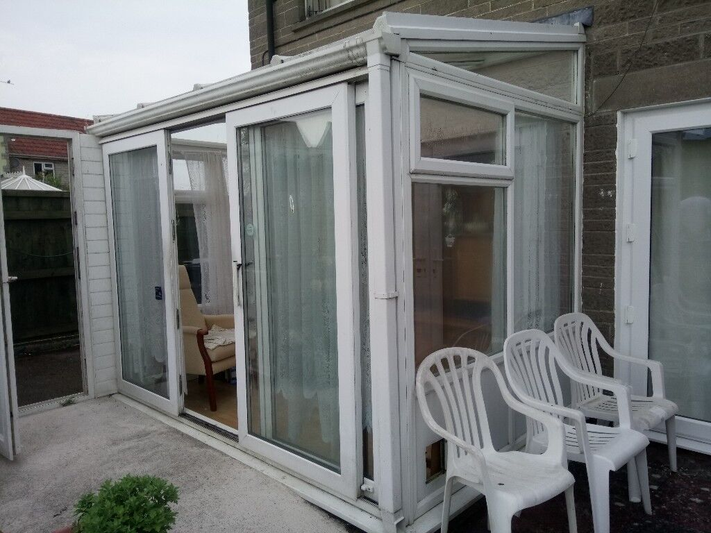 Lean To Conservatory With Sliding Door And Opening Windows