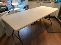 Folding portable 6ft trestle table - very new but small dent on the corner!