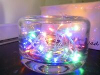 Heavy glass dish with LED lights.