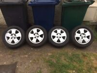 ford fiesta mk 5 alloys,14 inch,brand new tyres,nice wheels,£100,no offers