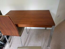 Well worn but functioning table and 4 chairs