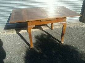 Drawer leaf dining table