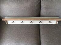 Shelf with coat hooks