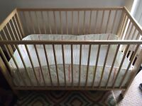 Wooden baby crib with mattress and pad - lightly used
