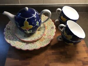 Tea pot, Mugs and serving plates