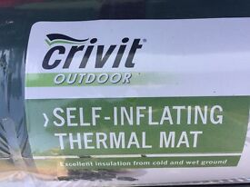Two brand new green Crivit self-inflating camping mats. In original packaging.