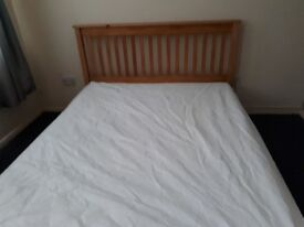 Wooden king size bed and mattress.