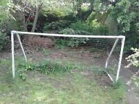 Free garden goal posts approx 6 feet by 3 feet, small hole in net.