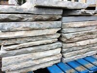 NEW 600 X 600MM GREY NATURAL STONE PAVING.