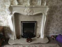 Adams fire surround with marble hearth and backplate together with electric fire
