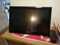 A 22 inch LG wall mount television