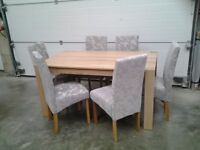 Ex display Dining table and 6 chairs (grey fabric) Bargain Can deliver.