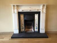 Fireplace Wooden surround with cast iron and tiled inset