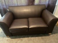 Brown new leather sofa