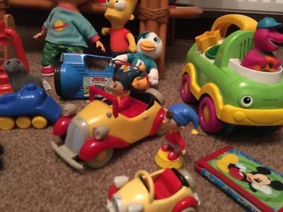 Child's toy collection and Bart from Simpsons, Chucky from Rugrats