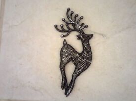 2 lovely sparkly black reindeer and a star...........only 50p each