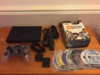 PlayStation 2 console, with many games